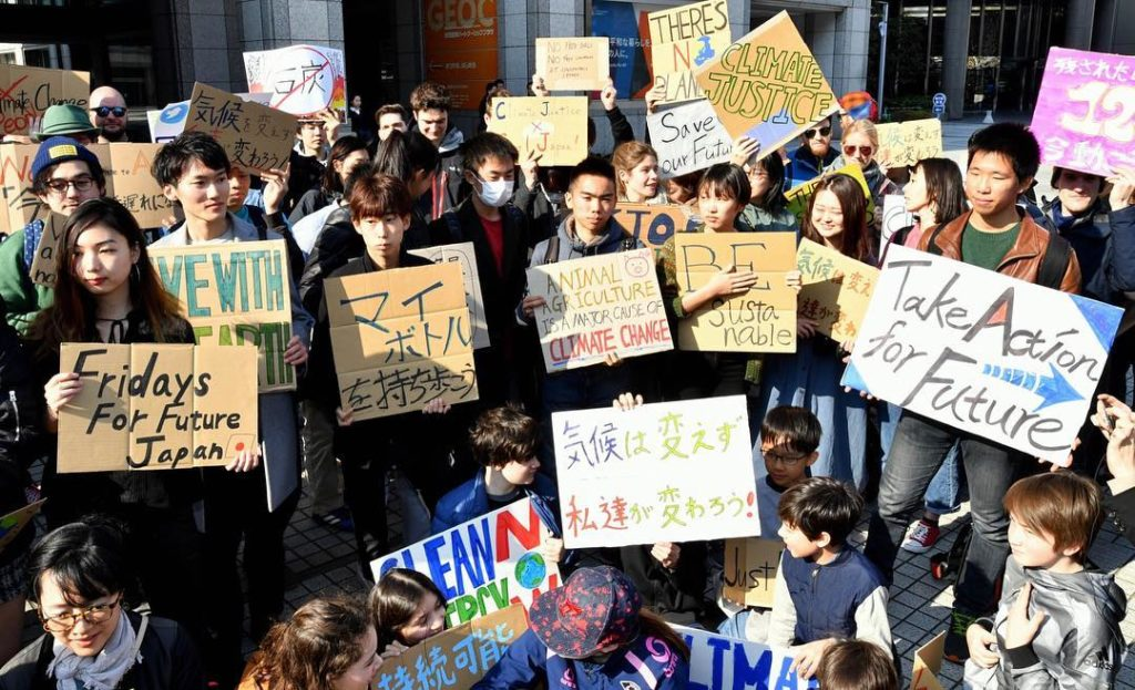Participants in a rally calling for action on climate change — part of a worldwi...