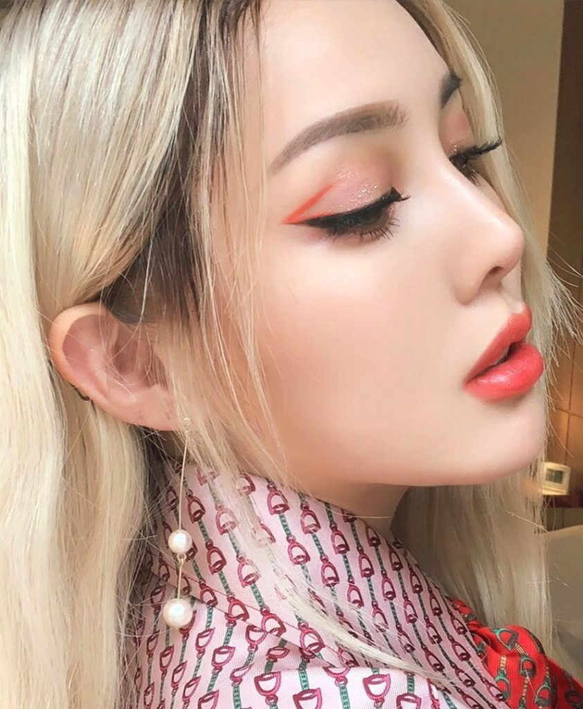 @ponysmakeup creates summer-stained lips with ColorGel Lip Balm in Tiger Lily, a...