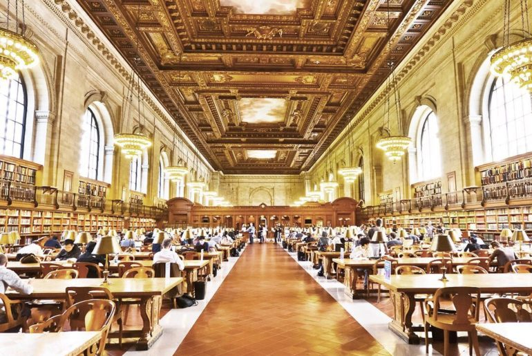 ⠀ New York Public Library's Reading Room, with it's expansive and ornate decor, ...