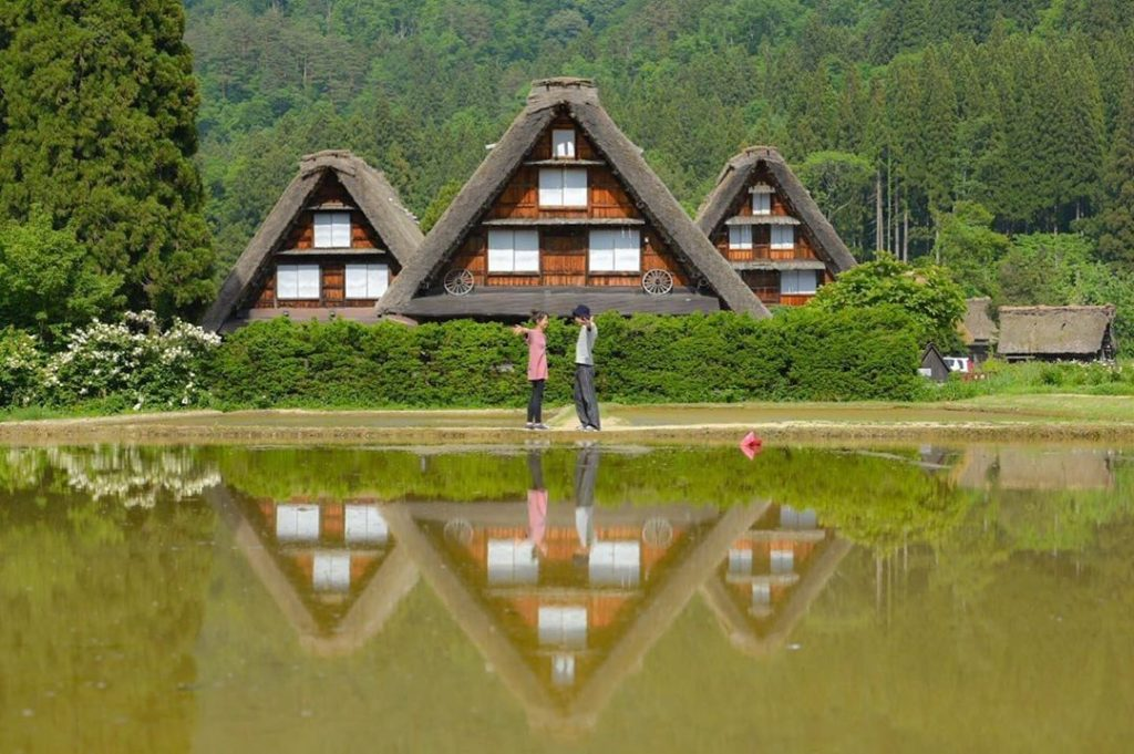 Gorgeous traditional farmhouses in Shirakawago reflected in the rice fields!  Th...