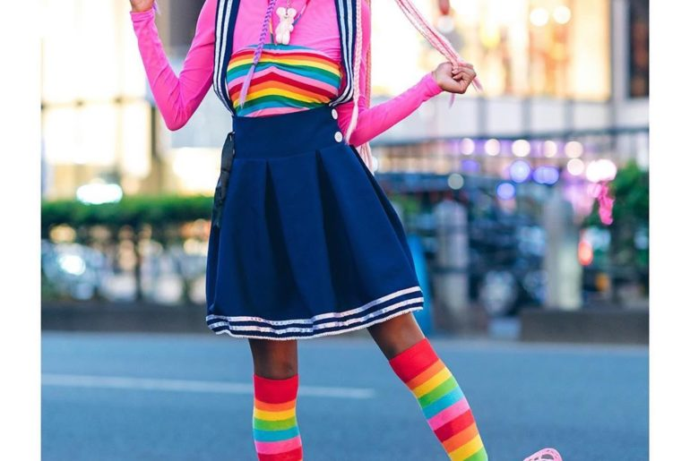 Sierra (@frokyo) on the street in Harajuku wearing a rainbow top and matching ra...