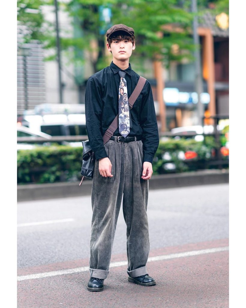 19-year-old Japanese student Asahi wearing a vintage sourced look on the street ...