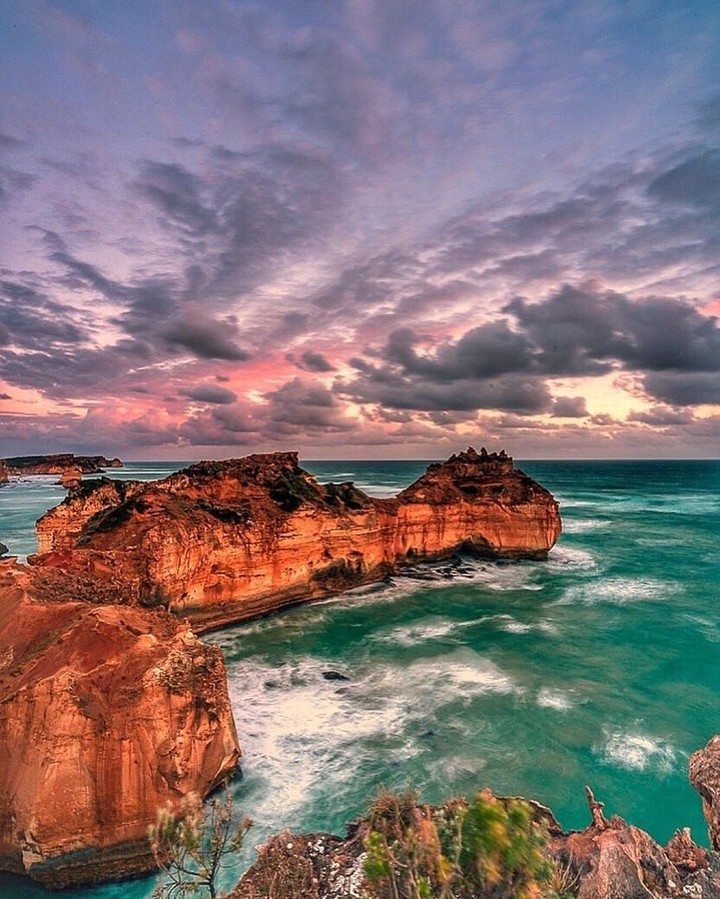 . The Great Ocean Road meanders along the stunning natural landscape of Australi...