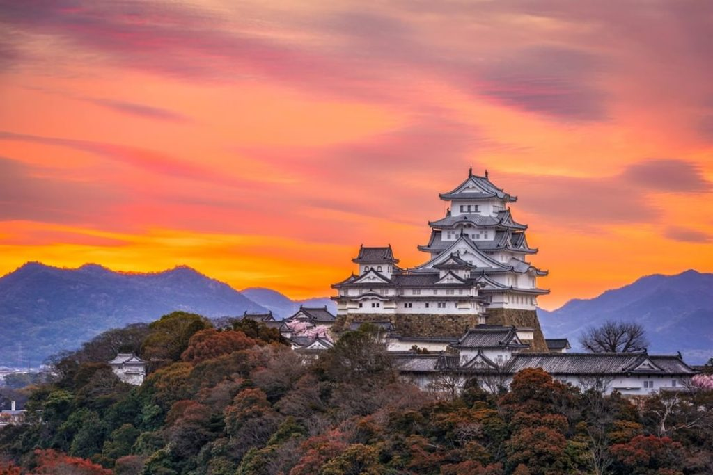High upon a hill overlooking the city, Himeji Castle's white flanks are an impos...