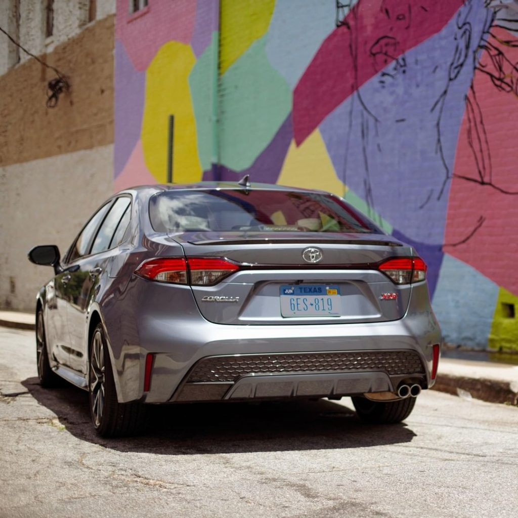 Pull away and leave a strong impression with the metallic rear spoiler. #Corolla...