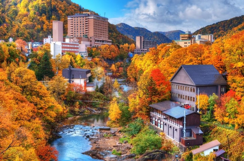 Soaking in hot springs while gazing at fall leaves is perhaps one of the most re...