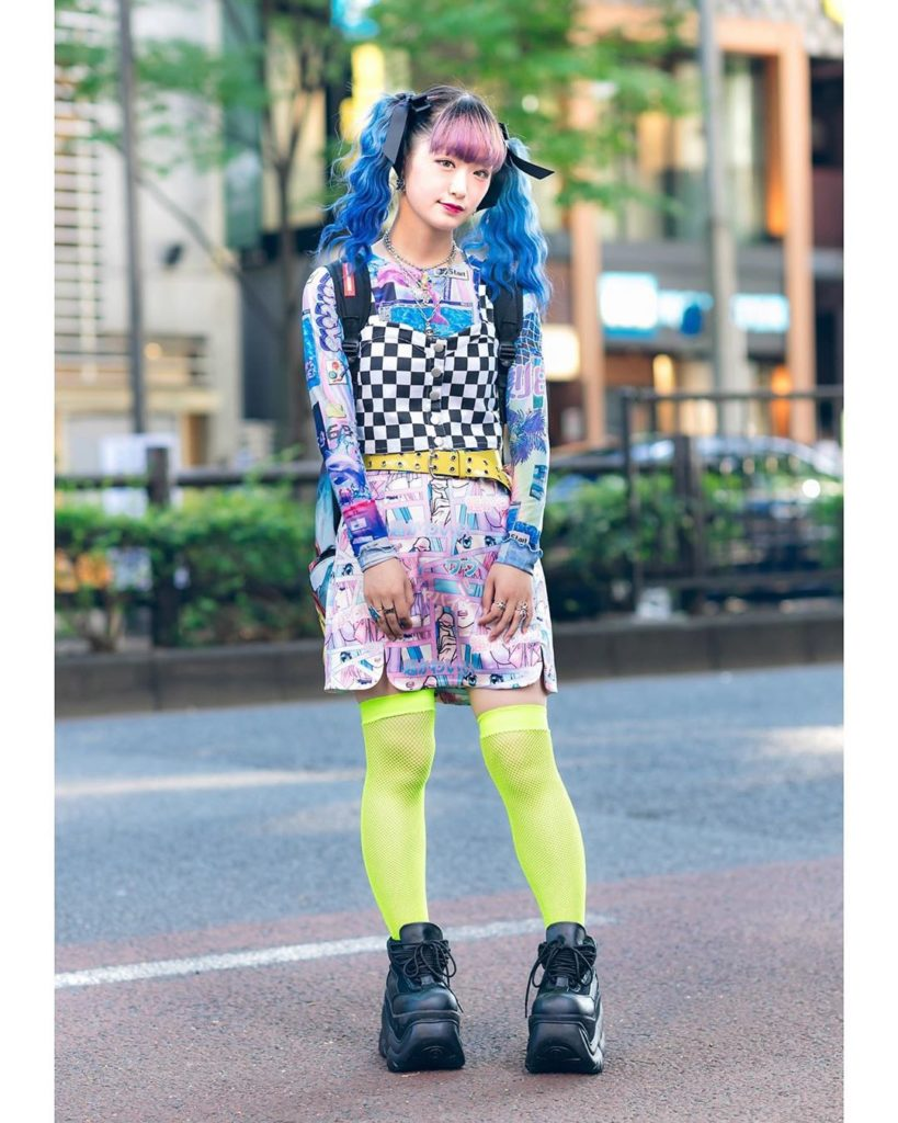 Hiyoko on the street in Harajuku wearing a checkered crop top over a graphic Spi...