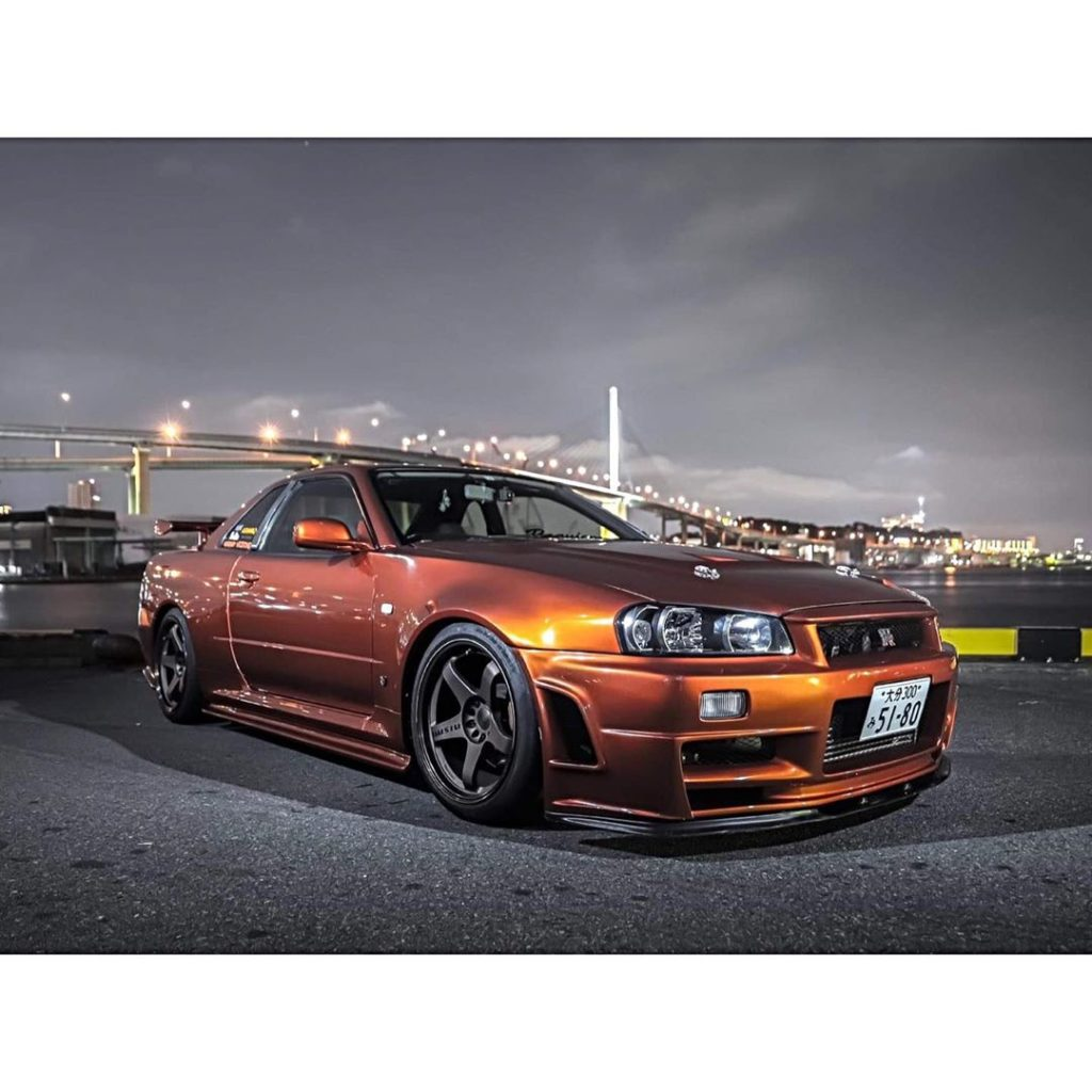Who loves the R34 in orange then?  Photo  @lowlife_car_photography . . . . Follo...