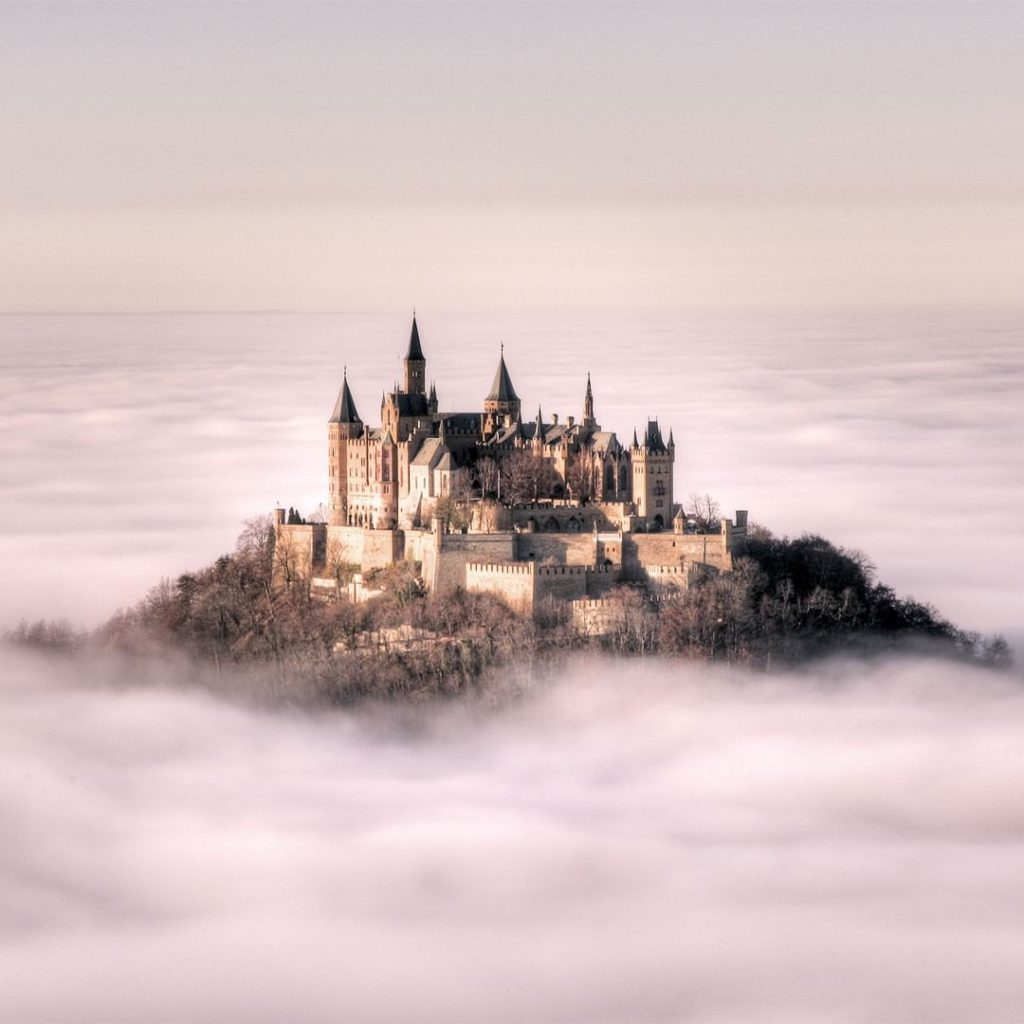 . Hohenzollern Castle, one of Germany's most famous, peaks mysteriously above th...