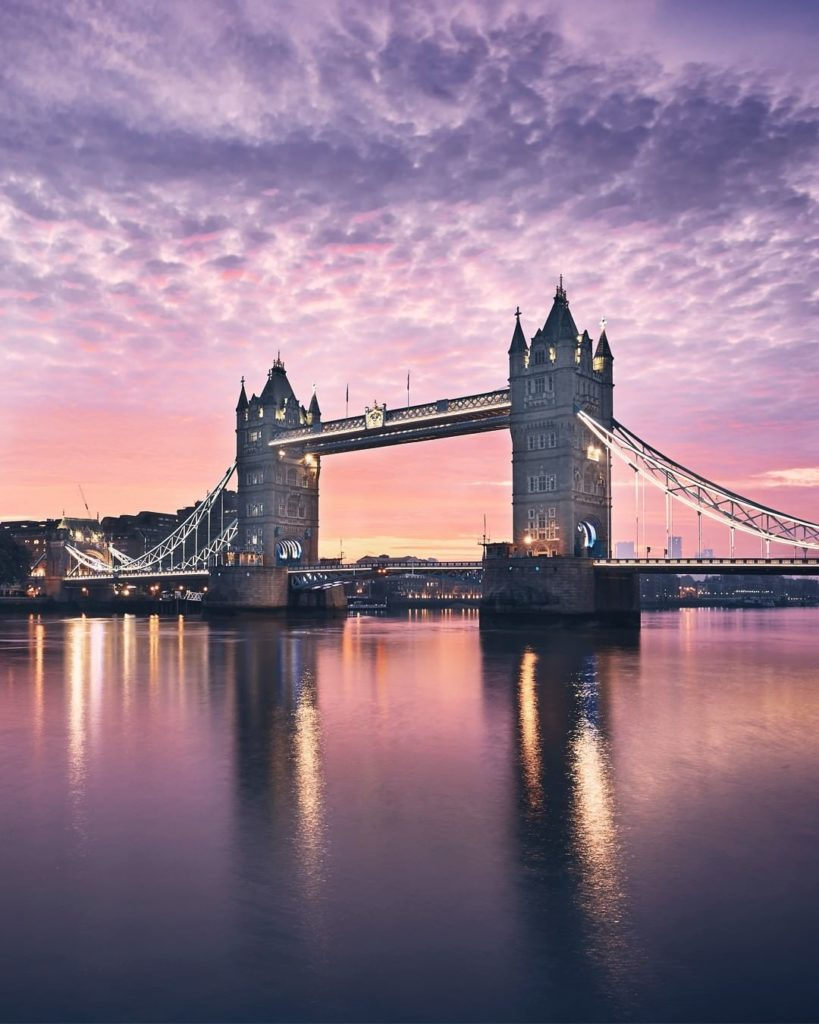 . London's iconic Tower Bridge stands against a painted sky. Imagine the view fr...