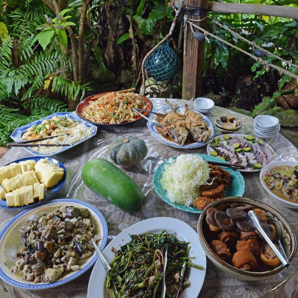 A feast of Okinawan food prepared by Masashi Miyagi is set out, family-style, fo...