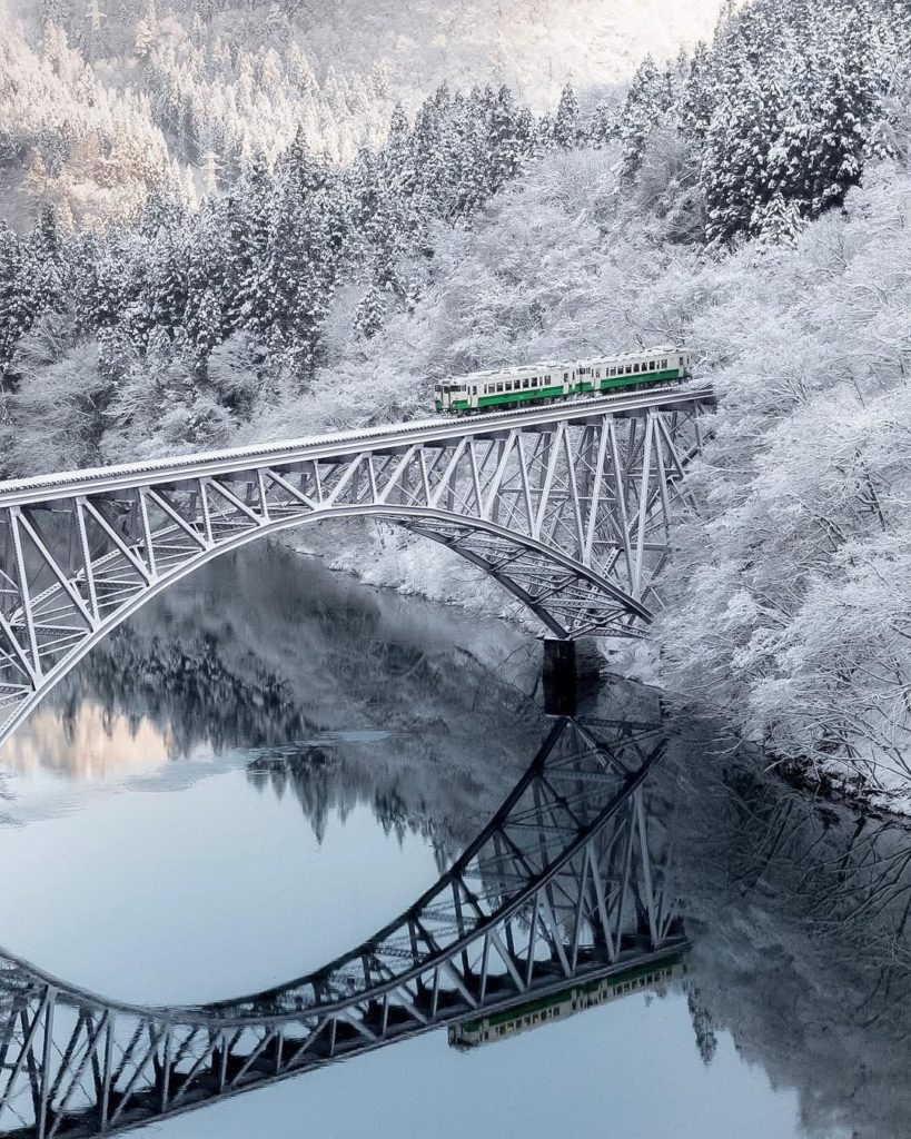 . Passengers on the Tadami Line are treated to a magnificent view of the silver ...